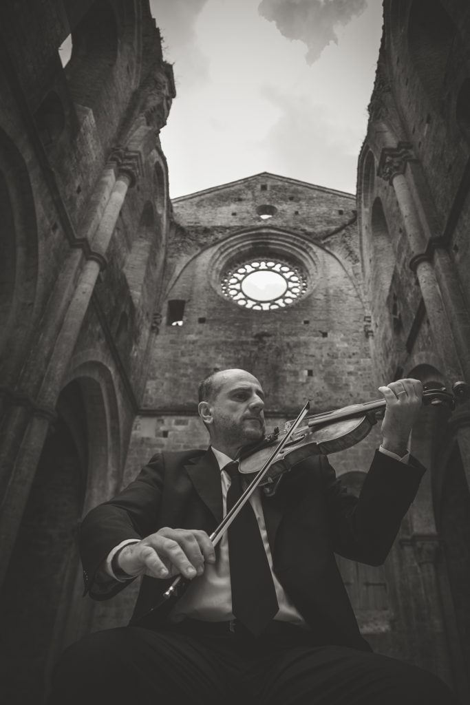 violinist in san galgano abbey siena