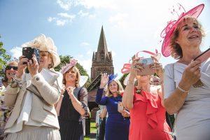 british guests at confetti at the church St. Bartholomew's Thurstaston england