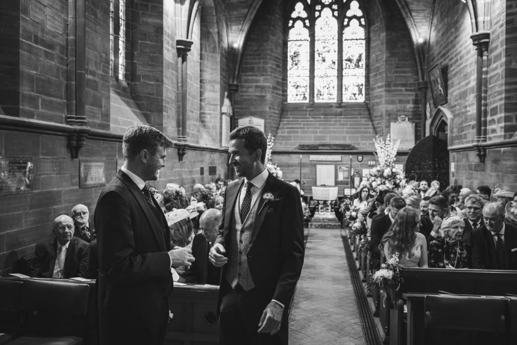 groom and best man at St. Bartholomew's Thurstaston england