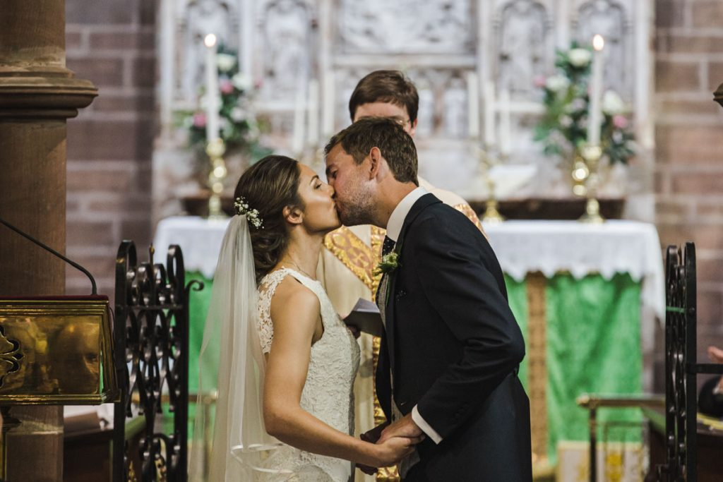 first kiss at exchanging vows at St. Bartholomew's Thurstaston england