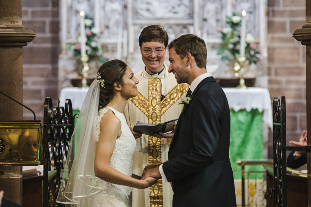 exchanging vows at St. Bartholomew's Thurstaston england