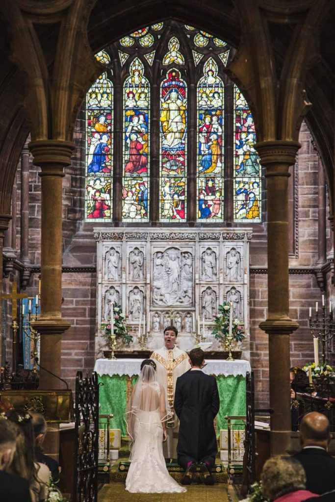 bride and groom at St. Bartholomew's Thurstaston england