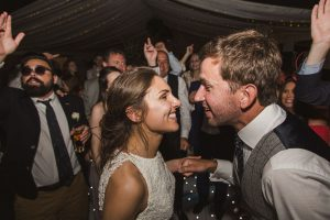 bride and groom dances