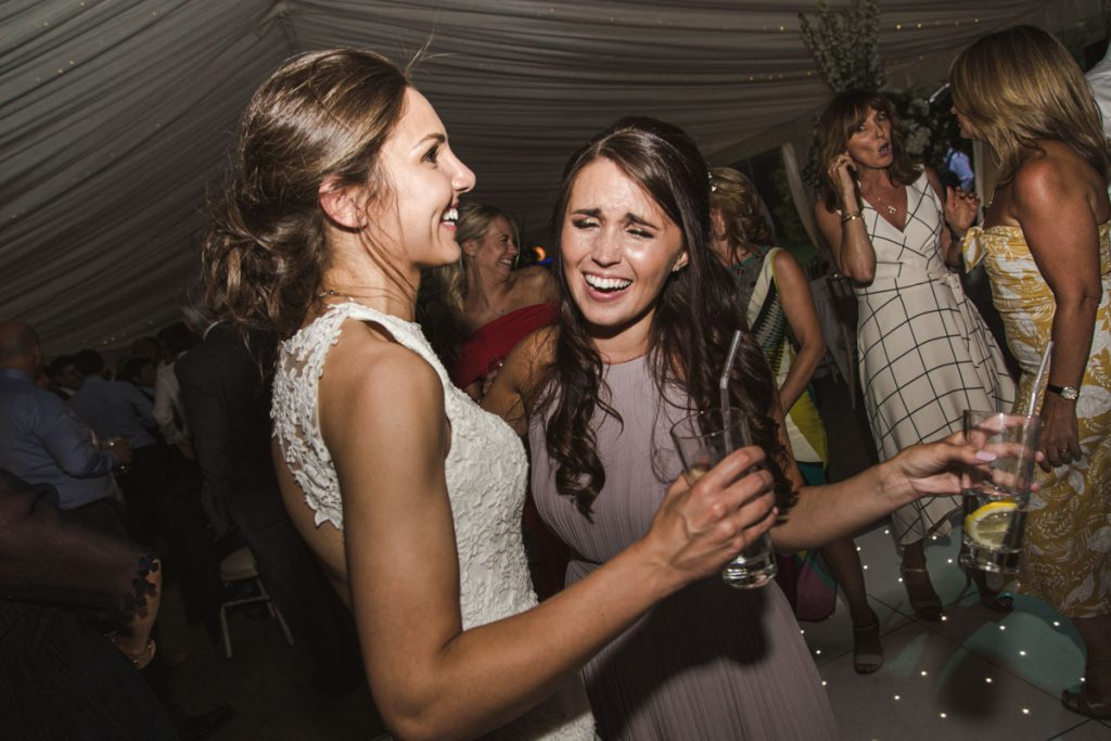 bride and maid of honor at wedding party